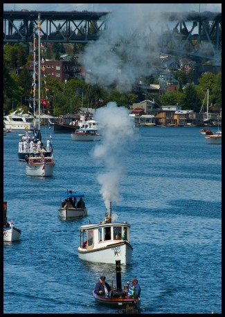 boats prepare to enter the Montlake Cut during the Opening Day Parade